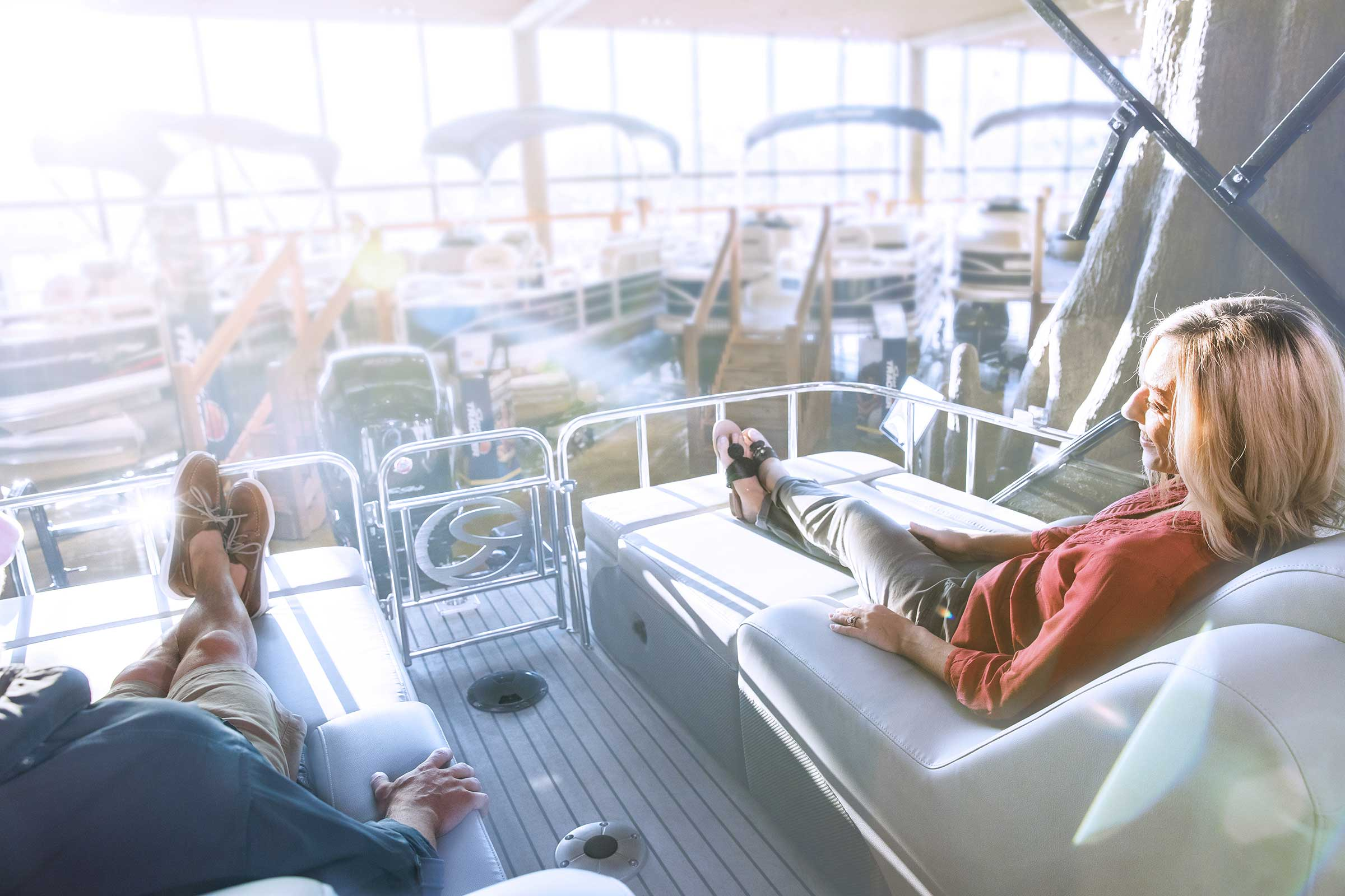 Couple sitting on boat in showroom